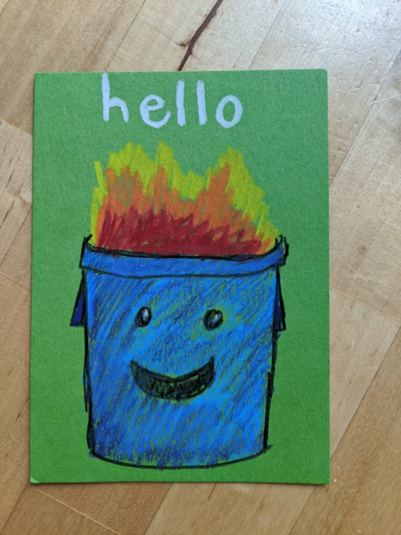 drawing of a smiling trash can on fire